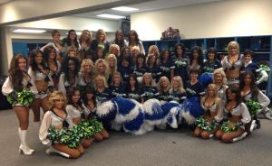 2013 Sea Gals with alumni in the locker room at the Seahawks vs. Bucs game 11-3-13.